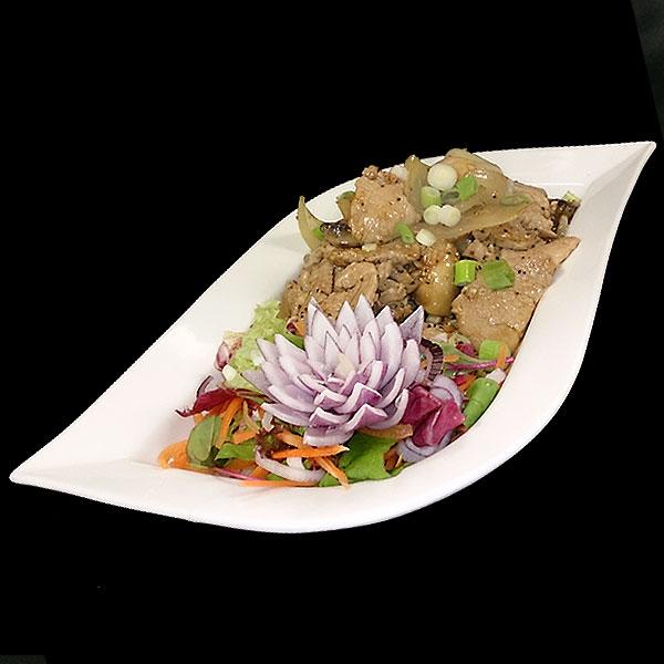 23 Sliced chicken breast with onion, mushroom, garlic & pepper sauce.
