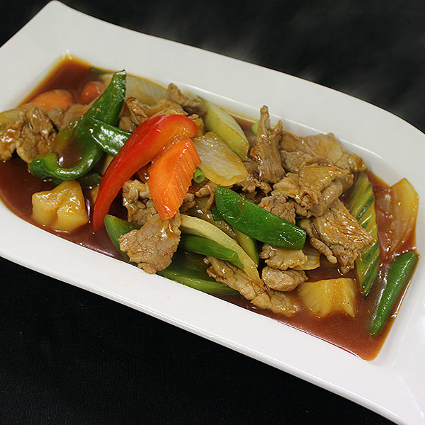37 Sweet & sour fillet of pork with savoury selection of mixed vegetables.