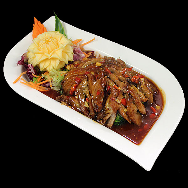 41 Crispy roast duck in a spicy sweet and sour sauce.