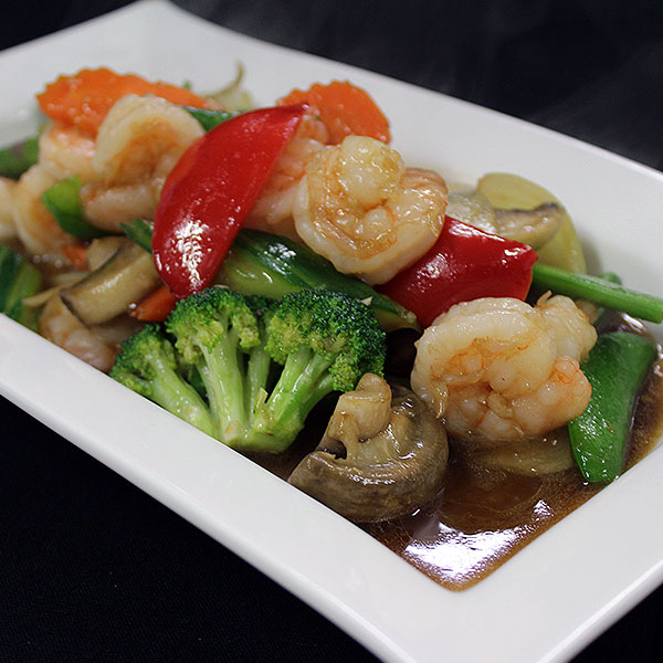 58. Gung Phad Pak Ruam Stir-fried tiger prawn with a savoury combination of mixed vegetables in oyster sauce.