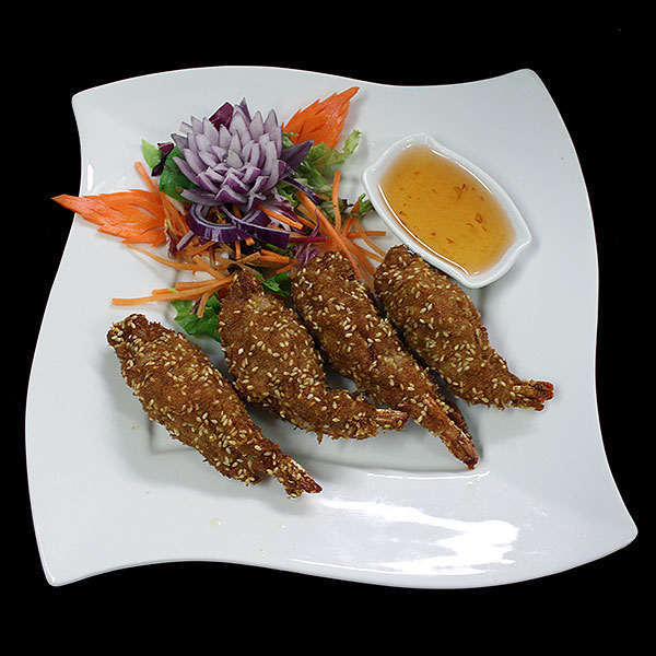 7 Tiger prawn with mince prawn, coated in breadcrumbs, served with plum sauce.