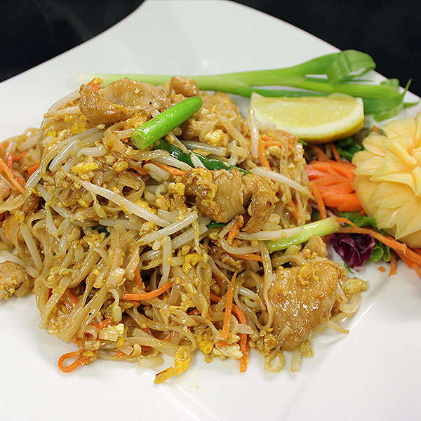 73 Chicken with Thai noodles with egg, spring onion, ground peanuts, & bean sprouts. A very popular favourite.