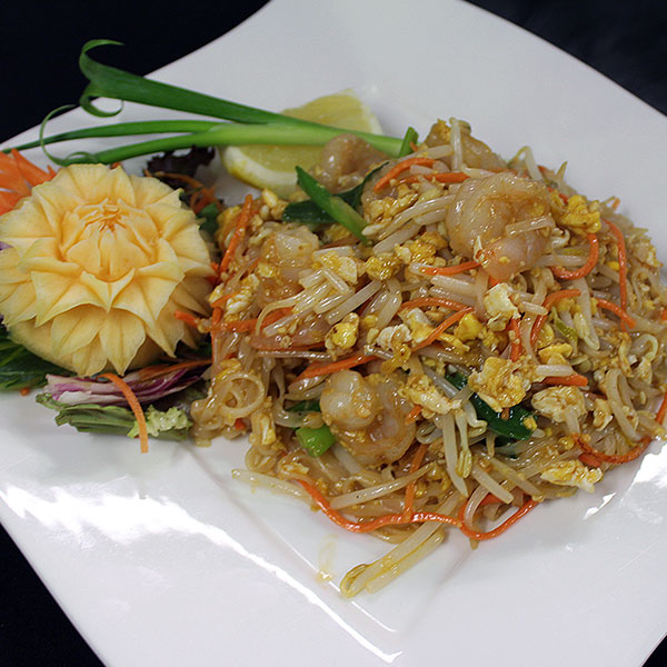 73 Prawn with Thai noodles with egg, spring onion, ground peanuts, & bean sprouts. A very popular favourite.