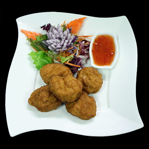 9 Thai spicy fish cakes served with plum sauce.