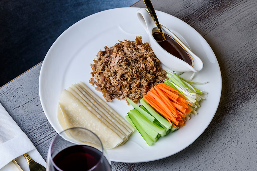 AROMATIC DUCK SERVED WITH PANCAKES, HOISIN SAUCE & JULIENNE OF CUCUMBER, CARROT & SPRING ONION (4,8,9,10)
