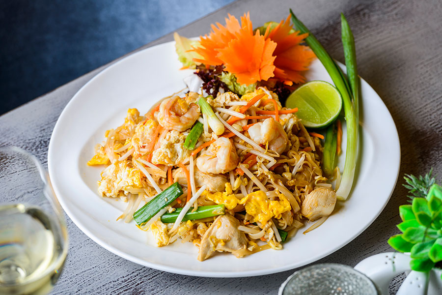 PHAD THAI - THAI NOODLES WITH EGG, SPRING ONION, CARROTS, GROUND PEANUTS & BEAN SPROUTS - PRAWNS (1,4,5,6,9,9A) and CHICKEN (1,4,5,9,9A)